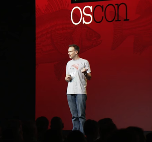 on stage at OSCON